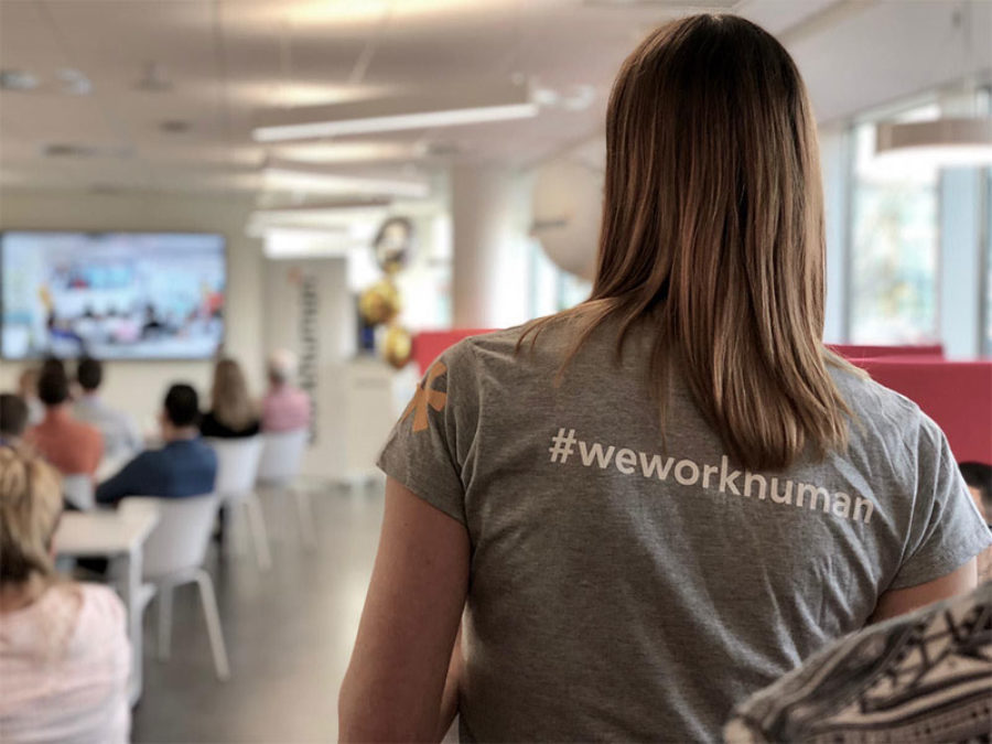 woman wearing workhuman shirt with her back turned